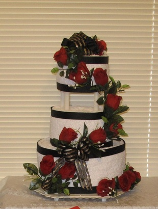 this towel cake was commissioned for a bridal shower using the brides wedding colors and flowers